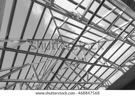 Black and white photo,Structure of steel roof frame for building construction.The advantage of this structure is lightweight but strong.
