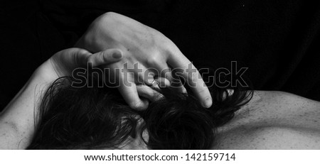 Black-and-white photography. Women's hands and back close-up.