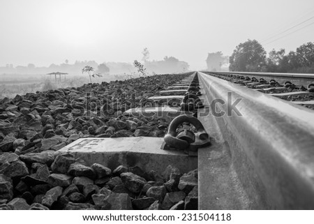Black and white photos,railroad in the morning - stock photo