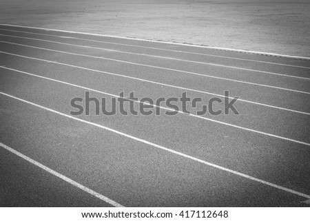 black and white photos.Running track for the athletes background - stock photo