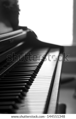 black and white piano detail, music, melody. - stock photo