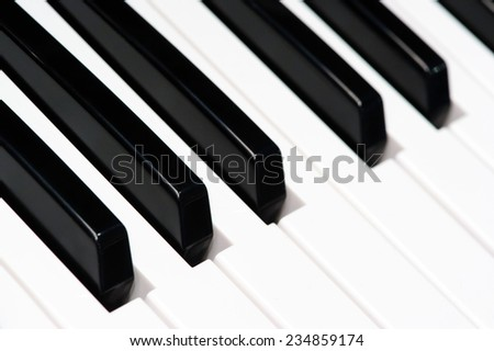 Black and white piano keys, keyboard of classical music instrument. Blurry closeup. - stock photo