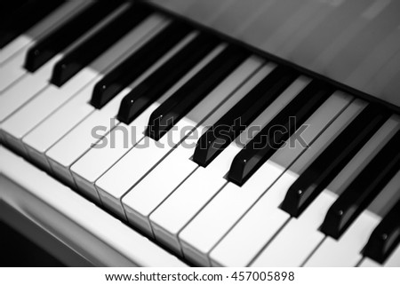 Black and white piano keys, musical keyboard instrument. Perfect equipment to extract the sounds. Classical music.  - stock photo