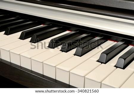 Black and white piano keys of the piano - stock photo