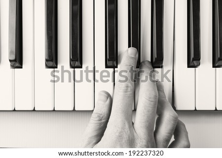 Black and white, piano player viewed from above - stock photo