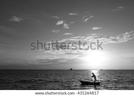 Black and white picture, Boat in the sea at dusk.