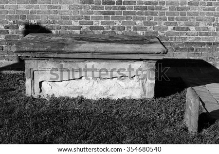 Black and white picture of a grave  next to church in Williamsburg colonial town in Virginia in the United States of America - stock photo