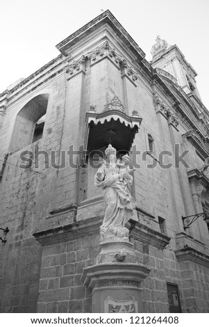 Black and White Picture of a Street Corner with statue ( Valletta, Malta ) - stock photo