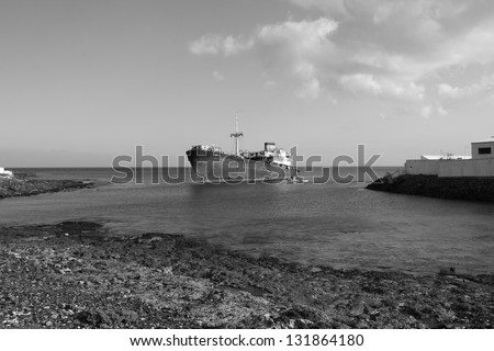 Black And White picture of an Old Wreck in the Port of Arrecife, Atlantic Sea (Lanzarote Island Spain) - stock photo