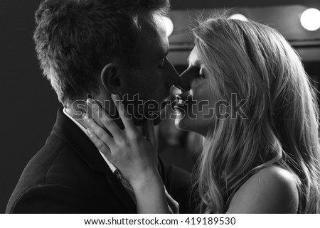 Black and white picture of attractive kissing couple - stock photo