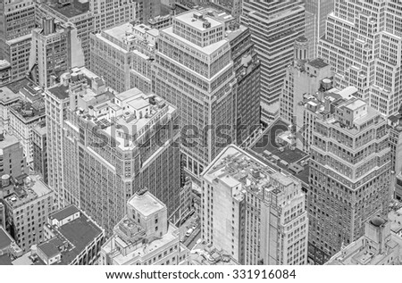 Black and white picture of highrise buildings, Manhattan in New York City, USA.