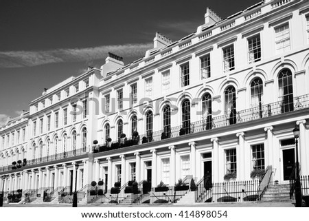 Black and white picture of old fashioned typical Regency Georgian terraced town houses building architecture in fashionable Notting Hill, Kensington, London, England, UK. - stock photo
