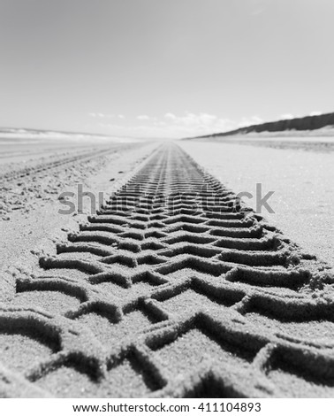 Black and white picture of  Wheel track on sand beach