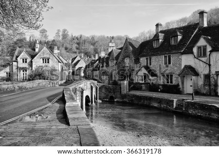 Black and white Picturesque Cotswold village of Castle Combe, England