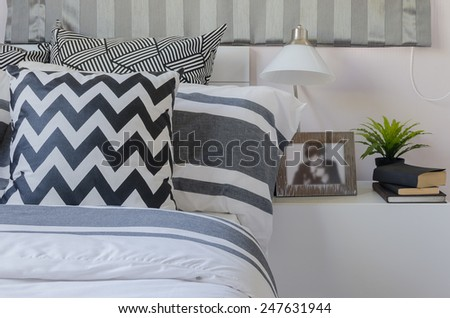 black and white pillows on bed in bedroom at home - stock photo