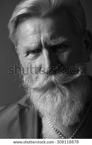 Black and White Portrait of a beard man with a long white beard.