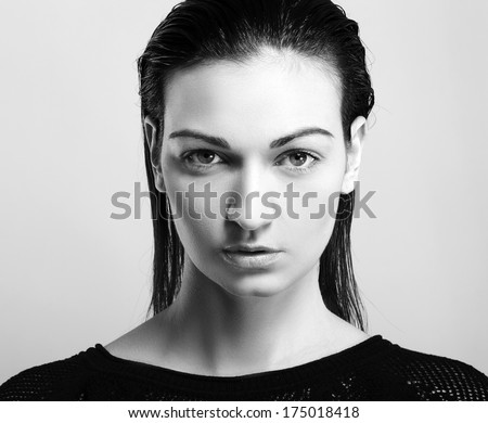 black and white portrait of a beautiful female model - stock photo