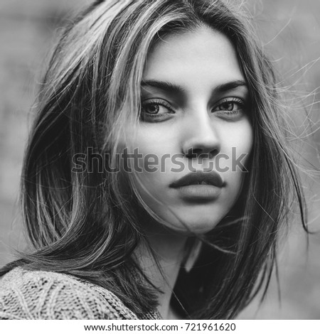 Black and white portrait of a beautiful girl face