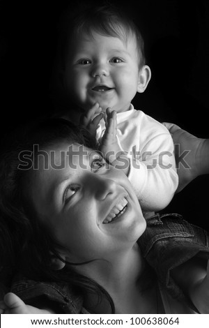 Black and white portrait of a beautiful happy mother and the little cute baby - stock photo