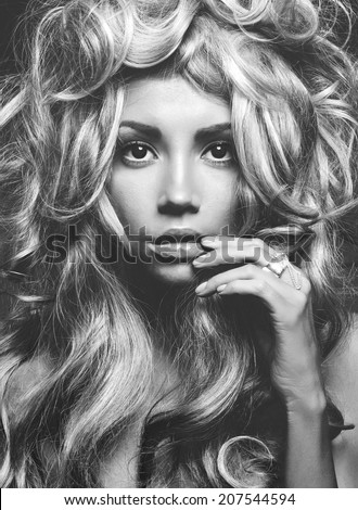 Black and white portrait of a beautiful woman with magnificent blonde hair. Hair extension, permed. - stock photo