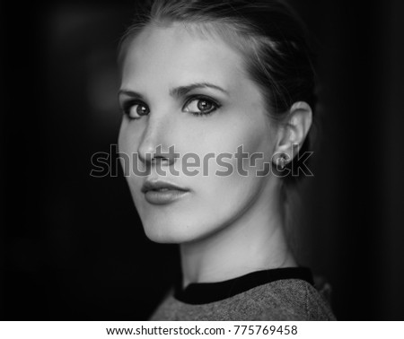 Black and white portrait of a beautiful young woman.