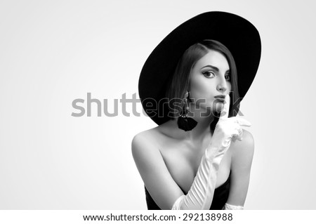 black and white portrait of a beautiful young woman in a hat - stock photo