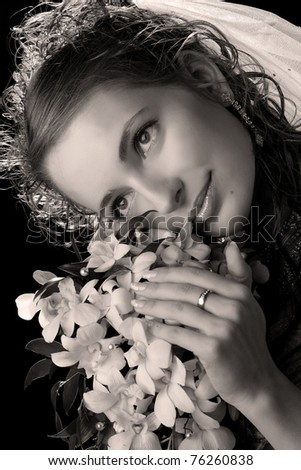 black and white portrait of a bride with a bouquet of flowers