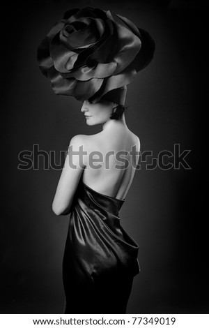 black and white portrait of a girl in a dark roses suit