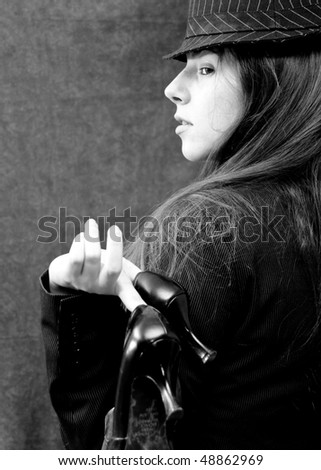 Black and White Portrait of a Girl in Business Attire and Heels Over Her Shoulder - stock photo