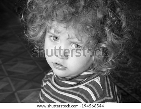 Black and white portrait of a little beautiful girl - stock photo