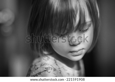 Black and white portrait of a little cute sleepy girl  - stock photo