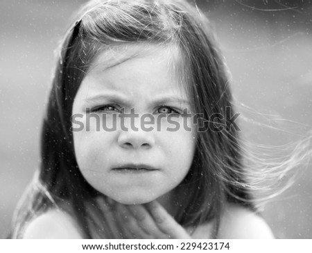 Black and White portrait of a little girl in snow - stock photo