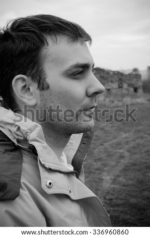 Black and white portrait of a man in profile - stock photo