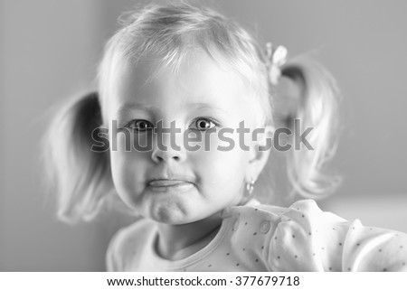 Black and white portrait of a pretty little girl