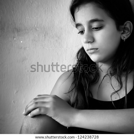 Black and white portrait of a sad and lonely girl - stock photo