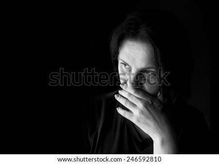 Black and white portrait of a sad woman - stock photo