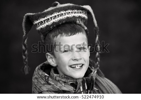 black and white portrait of a seven year old boy taken in mountains
