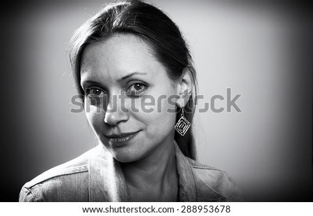 Black and white portrait of a 30-35-year-old adult beautiful woman - stock photo