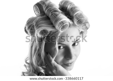 black and white portrait of a young blond girl in curlers