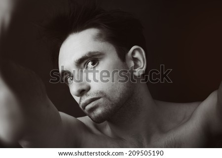 Black and white portrait of a young handsome man - stock photo