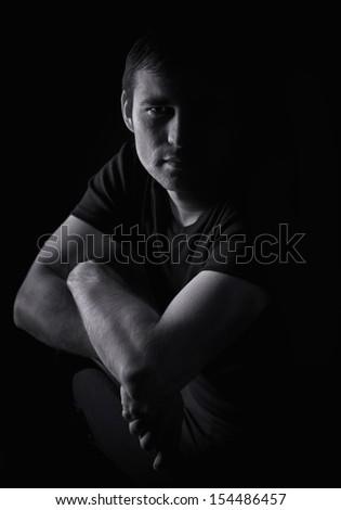 dramatic studio lighting. black and white portrait of a young man dramatic studio lighting e