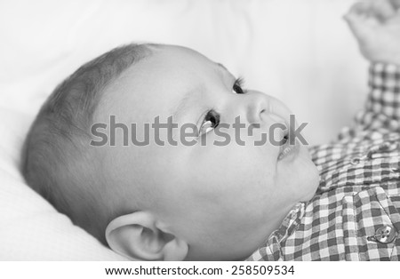 Black and white portrait of adorable infant baby boy - stock photo