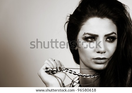 black and white portrait of an attractive Indian female fashion model - stock photo