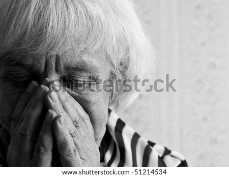 Black and white portrait of an elderly woman - stock photo