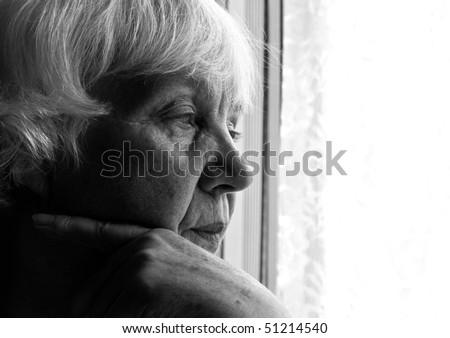 Black and white portrait of an elderly woman. Close-up. - stock photo