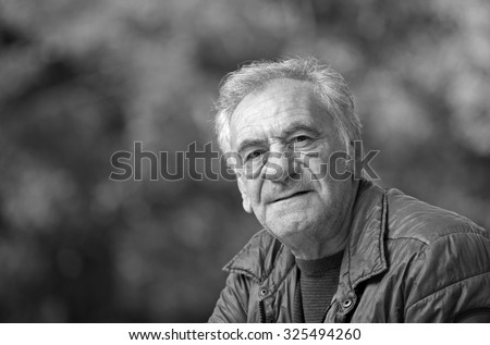 Black and white portrait of an handsome old man - stock photo
