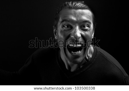 Black and white portrait of angry man shouting at camera - stock photo