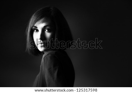 Black and white portrait of beautiful brunette woman with bob hairstyle - stock photo