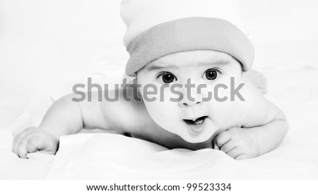 black and white portrait of beautiful little baby in a hat - stock photo