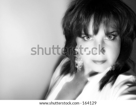 Black and white portrait of beautiful older woman - stock photo